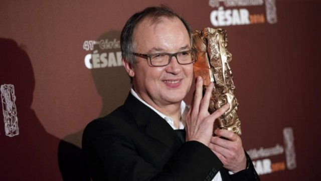 "French director Philippe Faucon poses with the Best Feature Film award for ""Fatima,"" during the 41st French Cesar Awards Ceremony, in Paris, Friday Feb. 26, 2016. This annual ceremony is presented by the French Academy of Cinema Arts and Techniques. (AP Photo/Thibault Camus)"